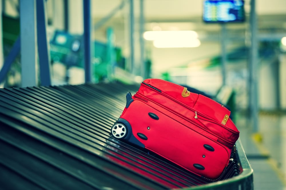 w23-4-Red Suitcase in Baggage Claim