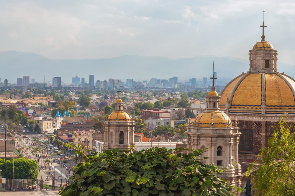 Romeo & Juliet- Old Basilica of Guadalupe with Mexico City skyline behind it