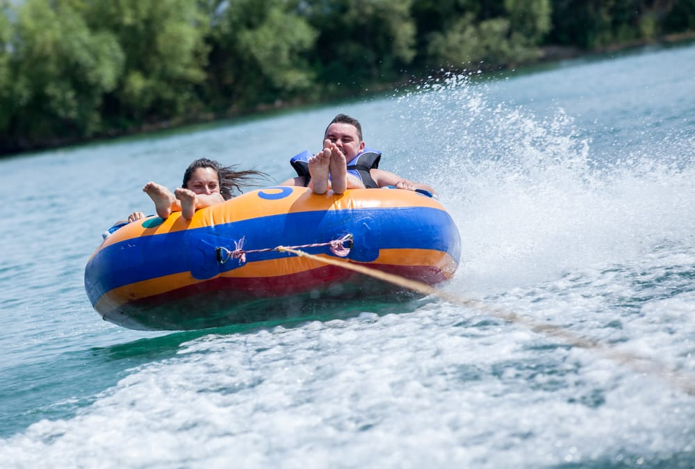 Young couiple on water attractions during summer vacations