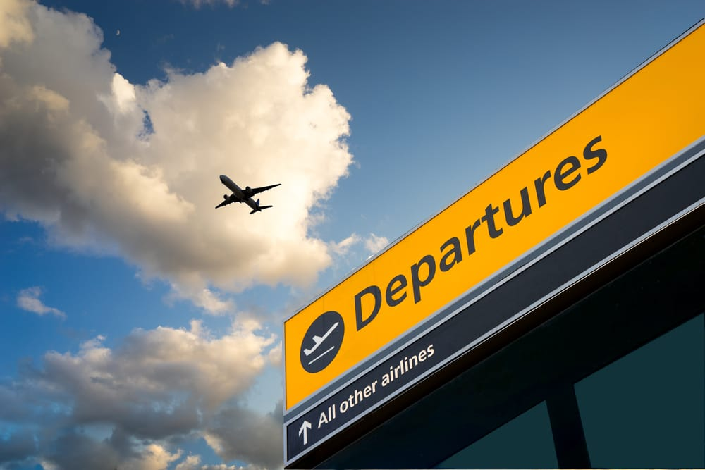 Airport Departure & Arrival information sign with sky