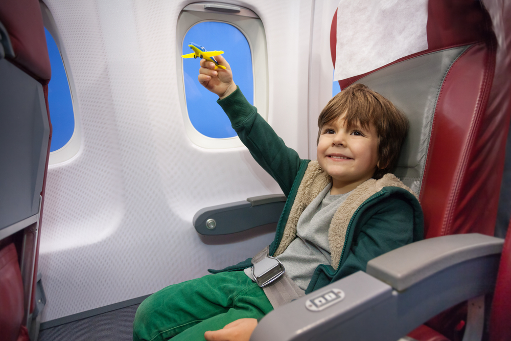 Body - little boy playing with plane