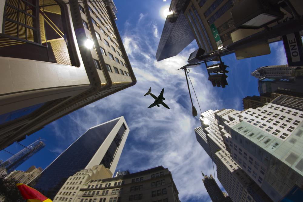Body - plane over skyscrapers