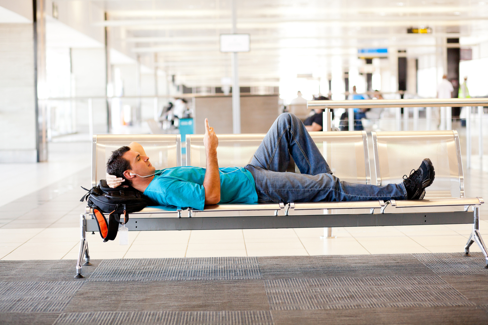 Body - guy relaxing in airport